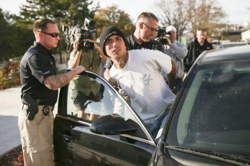 警方在盐湖城市区公共图书馆内被逮捕了嫌犯Austin Boutain。图片来自美联社
