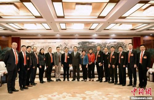 11月29日,国务院侨办副主任谭天星在北京会见孟加拉国华侨华人联合会访华团。中新社记者 张勤 摄