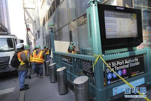 """12月11日,美国纽约市曼哈顿中城发生爆炸,导致4人受伤,多条地铁公交线停运。纽约市长德布拉西奥说,这是""""一起未遂恐怖袭击""""。新华社记者 王迎 摄"""