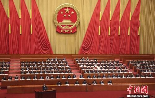 3月13日,十三届全国人大一次会议在北京人民大会堂举行第四次全体会议,听取国务委员王勇关于国务院机构改革方案的说明。 <a target='_blank' href='http://www.chinanews.com/'>中新社</a>记者 盛佳鹏 摄