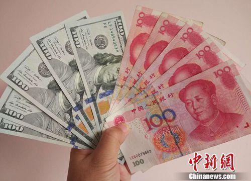 资料图:人民币和美元。<a target='_blank' href='http://www.chinanews.com/' >中新网</a>记者 李金磊 摄