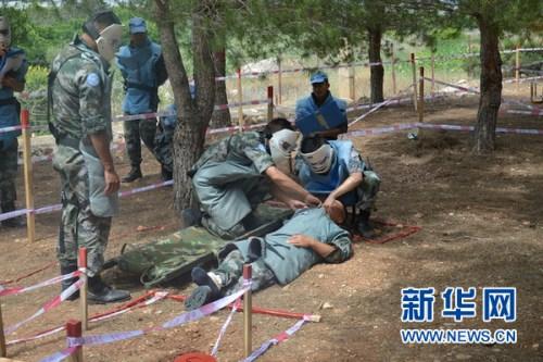 中国扫雷官兵雷场救援考核。新华网 杨双权摄
