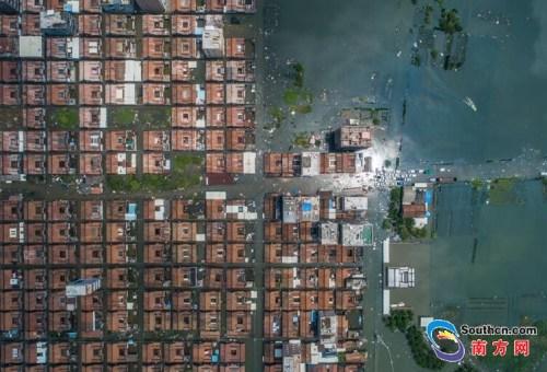 9月2日,天气转晴,水位开始慢慢下降,由于受灾严重,汕头潮南区司马浦镇依然被洪水围困。南方网全媒体记者 张由琼 实习生 徐杰 摄