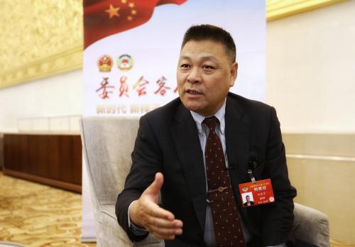 3月12日,西班牙温州同乡会会长刘继东在北京会议中心。(图片来源:欧洲时报特约记者李雪峰 摄)