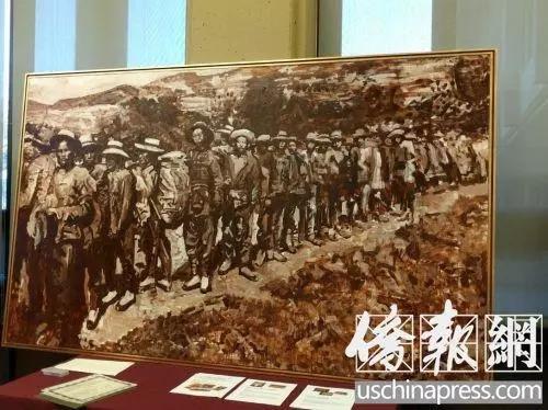 旅美画家创作反映铁路华工主题的油画《背井离乡》。(美国《侨报》张苗 摄)