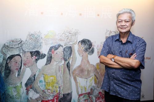 馬來西亞畫家潘金海和他的作品。(馬來西亞《星洲日報》/黃安健 攝)