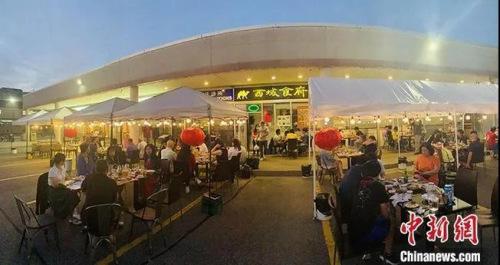 多国唐人街开始苏醒,来中餐馆吃露天大排档吗?