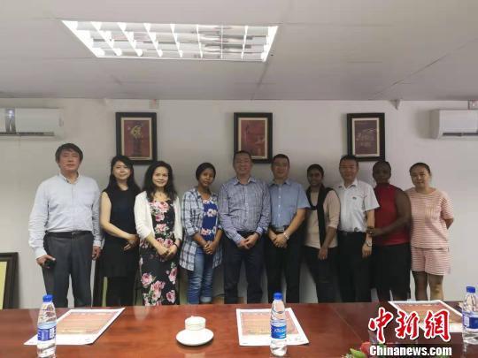 中新社访问团走访环球广域传媒集团