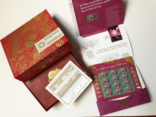 美华裔艺术家连画12年邮票猪生肖版本为收官之作